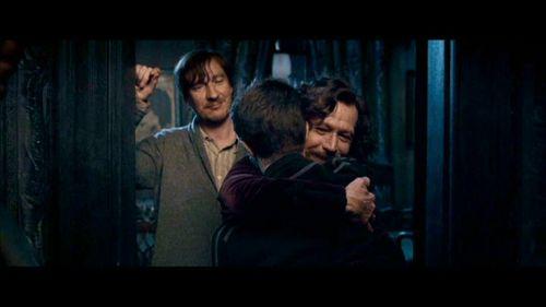Lupin y Sirius Black, con Harry, que está de espaldas